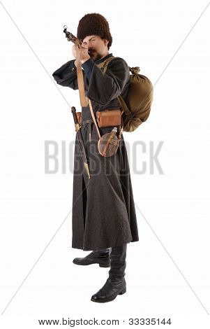 Man In Vintage Costume Of Russian Cossack Points A Rifle.