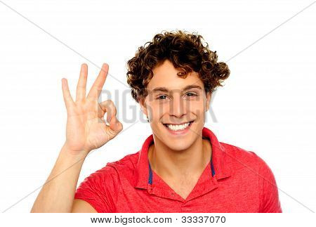 Curly Hair Guy Gesturing Excellence Sign