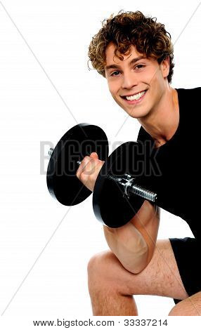 Strong Young Man Working Out With Dumbbells