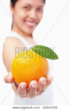 Woman holding orange, shot over white background