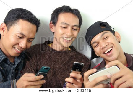 Three Man Having Fun On Mobile Device