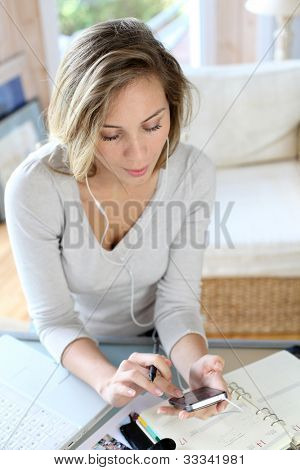 Woman typing message on smartphone