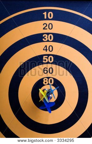 A Magnetic Dart Board With Darts