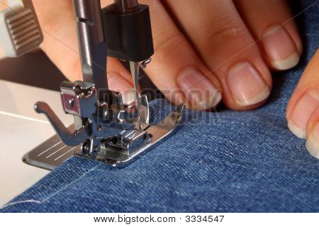 Hands Using A Sewing Machine