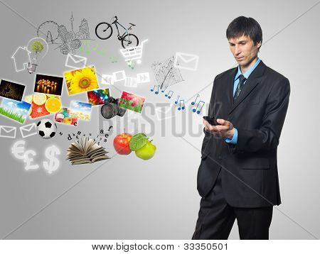 Businessman Using Mobile Phone With Touch Screen
