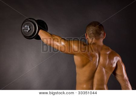 Muscled Male Bodybuilder Dumbbell Swing