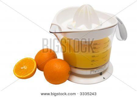 Juice Extractor And Ripe Oranges