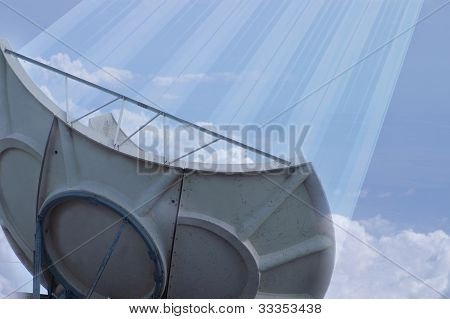 Satellite Dish Sending Signals Up Into Cloudy Sky