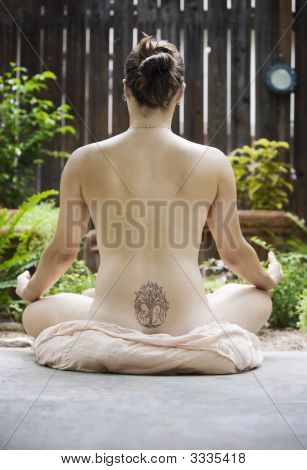 Back Of A Nude Woman Meditating