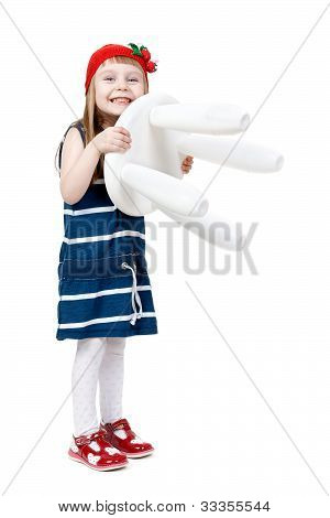 Little Girl With A White Chair In The Hands Of