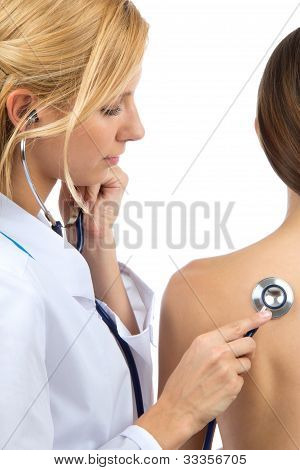 Doctor Auscultating  Patient By Stethoscope