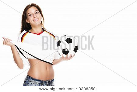 beautiful woman holding football pulling her football shirt