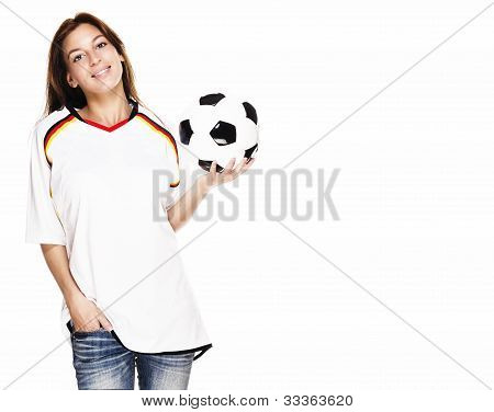 smiling woman wearing football shirt presenting a football