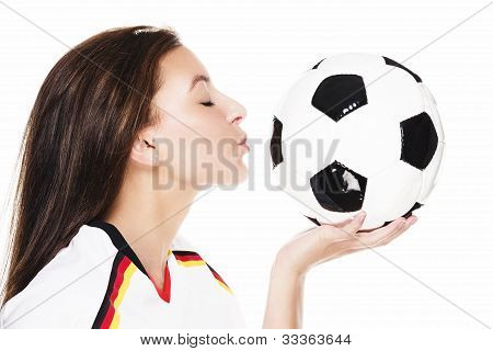 young beautiful woman about to kiss a football