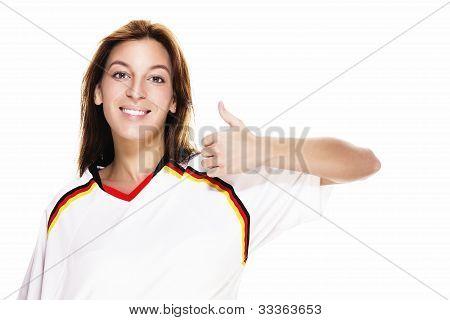 young woman wearing football shirt showing thumb up