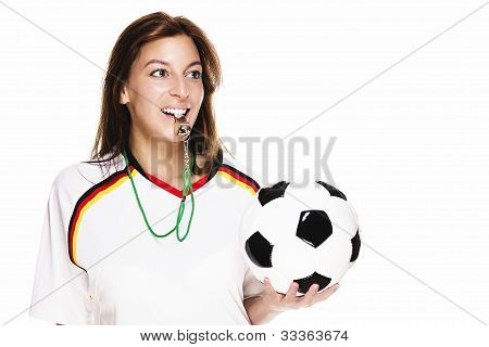 beautiful woman wearing football shirt with a whistle holding football