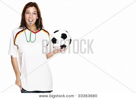 beautiful woman with a whistle wearing football shirt and holding football