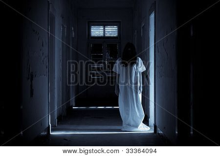 Terrified Horror Scene of a Scary Woman in White Dress