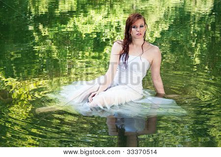 Woman Appearing To Float In Green Water