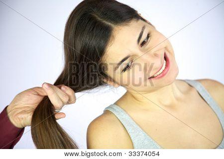 Hand Pulls Long Hair