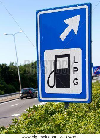 Filling station sign along a highway