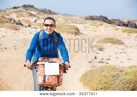 Woman having a excursion on bike