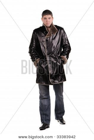 Studio Photo Of Trendy Young Man Walking On White Background