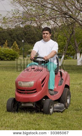 Ride-on lawn mower cutting grass