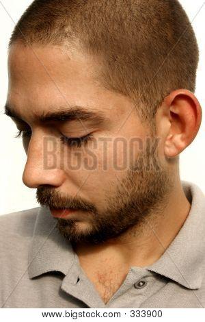 Hispanic Man Looking Down