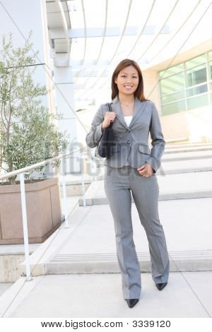 Pretty Asian Business Woman At Office Building