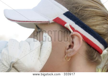 Lady Golfer With Hand Beside Face