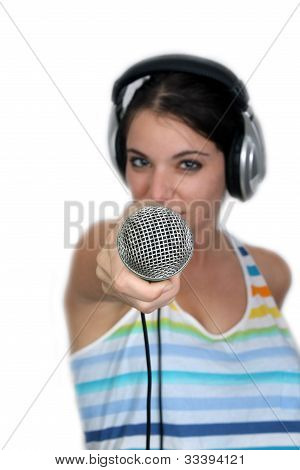 Attractive Brunette With Headphones And A Microphone (3)