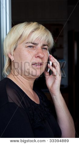 Middle-aged Woman Calling By Mobile Phone