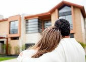 picture of heterosexual couple  - Loving couple looking at their dream house - JPG