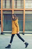 Fashion model walking and posing outdoor. Young blond caucasian woman posing winter outdoo. Beautifu poster