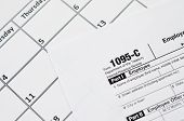 Irs Form 1095-c Employer-provided Health Insurance Offer And Coverage Tax Blank Lies On Empty Calend poster