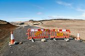 Closed road sign in Iceland due to natural disaster damages. The texts in Icelandic mean Closed an poster