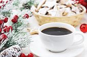 A White Mug Of Black Americano Coffee On A White Wooden Background Next To The Christmas Branch And  poster