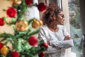 Sad Young Woman Celebrating Christmas At Home poster