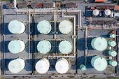 Aerial View Of Chemical Industry Storage Tank And Tanker Truck In Wailting In Industrial Plant To Tr poster