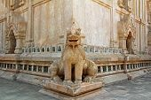 At Ananda Temple, Myanmar. Statue Of Chinthe Or Leogryph With Double -body Sitting At The Corner Of  poster