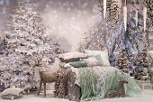 Cozy Bedroom Interior Decorated With Christmas Details: Soft Deer Toy, Christmas Tree, Branches At T poster