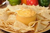 Tortilla Chips With Spicy Cheese Dip poster