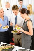 pic of buffet catering  - Business colleagues eat buffet appetizers catering service company event - JPG
