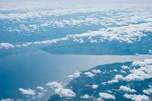 Aerial View Of The Land And Sea Over Clouds In Danmark. poster