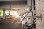 Cctv Cameras Are Installed On White Wall With Poles In The Parking Lot. Security Camera Or Surveilla poster