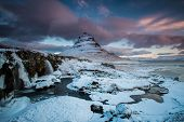 The Sunrise At Snowy Kirkjufell Hill And Frozen Waterfall With Morning Aurora After Long Cold Night  poster