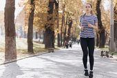 Young Woman Runner Training In Summer Park. Close Up Fitness Woman Jogging Outdoor. Tired Girl Jogge poster