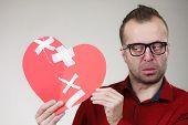 Funny Man Holds Broken Heart poster