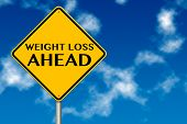 picture of healthy food  - Weight Loss ahead sign showing business concept on a sky background - JPG